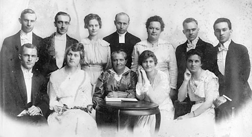 The John Nilsson Alexis Family, July, 1917 Front row: Joseph Alexis, Magda (Joseph) Alexis, Ingrid Alexis (mother), Helen (Oscar) Alexis, Olga (Gerhard) Alexis Back row: Crispin Alexis, Carl Alexis, Tekla Alexis, Rev. Emil Valberg, Theresia (Emil) Valberg (nee Alexis), Oscar Alexis, Gerhard Alexis Not pictured: Rev. John Nilsson Alexis (father), deceased 1912